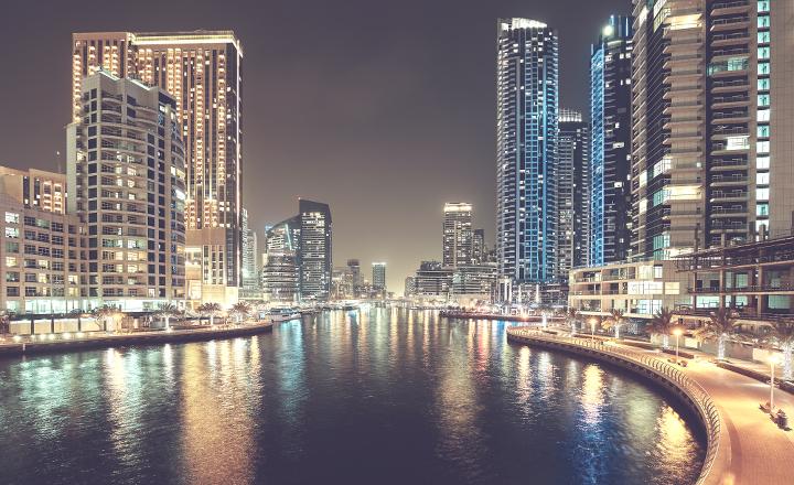 Dubai Marina at night, color toning applied, United Arab Emirates.